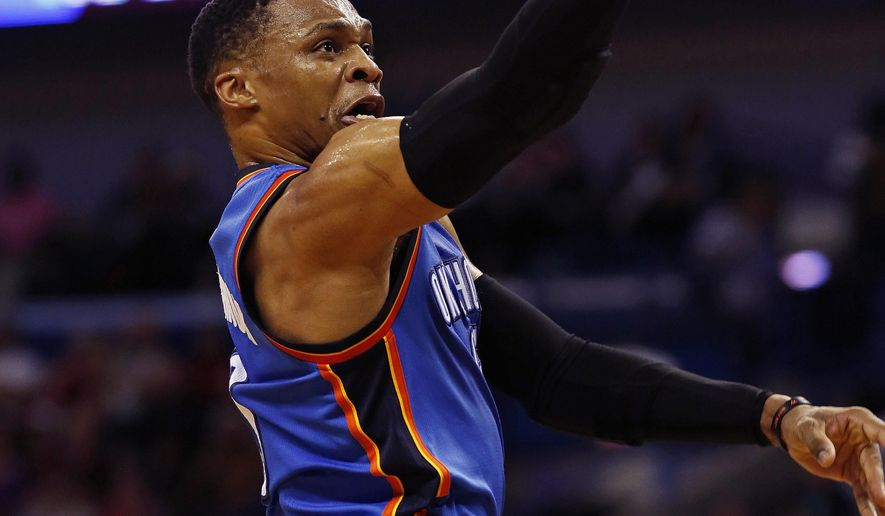 Oklahoma City Thunder guard Russell Westbrook, top, makes a layup against New Orleans Pelicans guard Tim Frazier, bottom, during the first half of an NBA basketball game in New Orleans, Wednesday, Dec. 21, 2016. (AP Photo/Max Becherer)