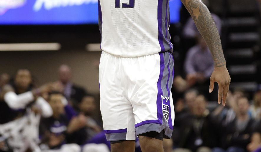 Sacramento Kings forward DeMarcus Cousins flashes three fingers after scoring a three-point basket against the Portland Trail Blazers during the second half of an NBA basketball game Tuesday, Dec. 20, 2016, in Sacramento, Calif. The Kings won 126-121.(AP Photo/Rich Pedroncelli)
