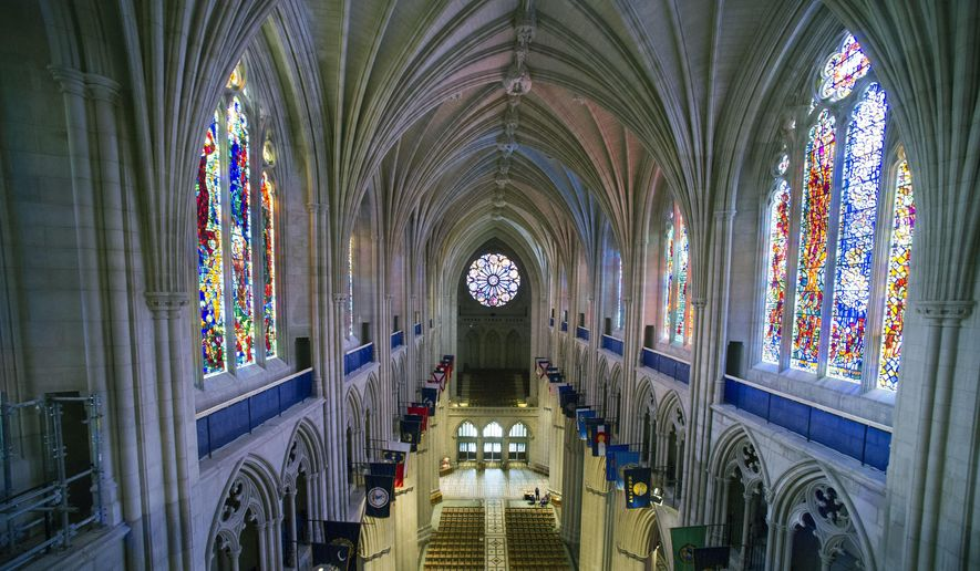 This Wednesday, Feb. 18, 2015, file photo shows the nave of the Washington National Cathedral in Washington. (AP Photo/Cliff Owen)