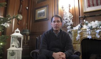 Wisconsin Gov. Scott Walker speaks during an interview with The Associated Press, Wednesday, Dec. 21, 2016, in Maple Bluff, Wis. Walker is promising not to leave mid-term or seek a fourth term in office if he decides to seek re-election in 2018 and wins.  (AP Photo/Scott Bauer)