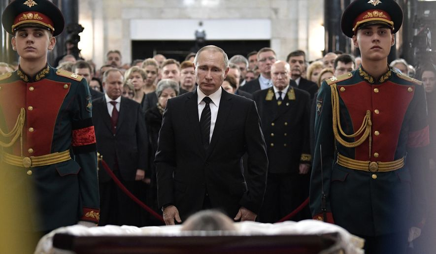 Russian President Vladimir Putin, center, attends a farewell ceremony for the Russian Ambassador to Turkey Andrei Karlov at the Foreign Ministry headquarters in Moscow, Russia, Thursday, Dec. 22, 2016. Karlov was fatally shot by a Turkish policeman Monday in a gathering in Ankara, Turkey. (Alexei Nikolsky/Sputnik, Kremlin Pool Photo via AP)