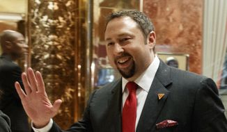 In this Nov. 29, 2016 photo, Jason Miller, Communications Director of President-elect Donald J. Trump's Transition Team, waves to reporters in the lobby of Trump Tower in New York. President-elect Donald Trump has named his senior communications team, choosing Sean Spicer as press secretary, Jason Miller as communications director, Hope Hicks as director of strategic communications and Daniel Scavino as director of Social Media.  (AP Photo/Evan Vucci)