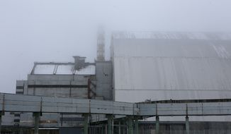 A view of a new shelter installed over the exploded reactor at the Chernobyl nuclear plant, Chernobyl, in Chernobyl, Ukraine, Thursday, Dec. 22, 2016. (AP Photo/Sergei Chuzavkov)