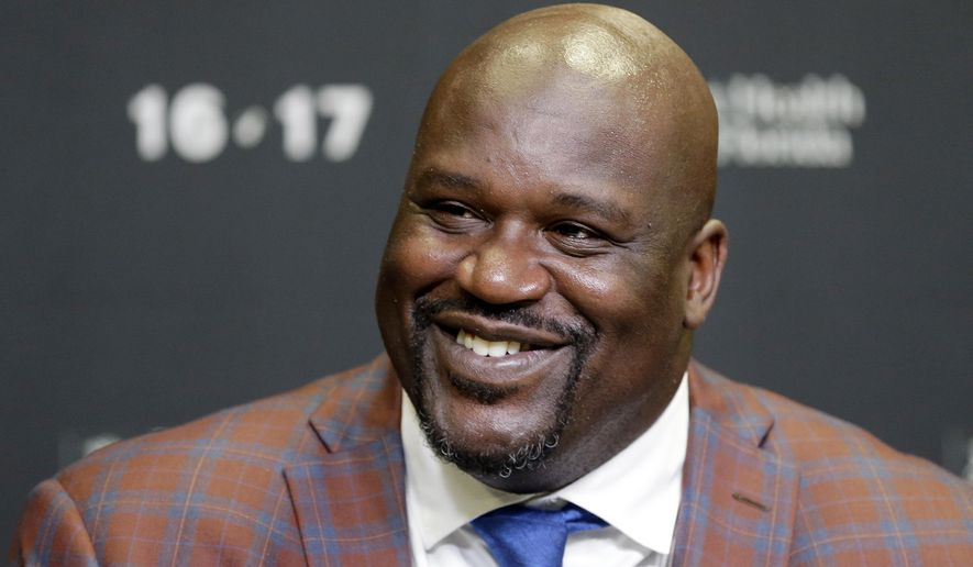 Retired Hall of Fame basketball player Shaquille O'Neal smiles as he talks to reporters during an NBA basketball news conference, Thursday, Dec. 22, 2016, in Miami. The Heat raise O'Neal's No. 32 banner to the rafters. He will be the third Heat player to get such an honor, joining only Alonzo Mourning and Tim Hardaway. (AP Photo/Alan Diaz)