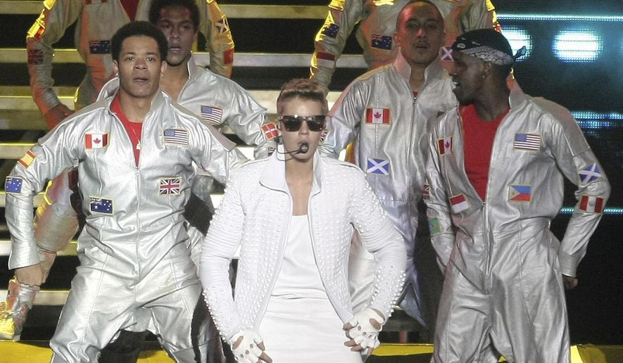FILE - In this Nov. 10, 2013 file photo, Canada's pop star Justin Bieber performs in concert during his Believe world tour in Buenos Aires, Argentina. A court in Argentina indicted Bieber on Tuesday, Dec. 20, 2016 for allegedly sending his bodyguards to beat up a photographer in Buenos Aires three years ago. (AP Photo/DyN, Pablo Molina, File)