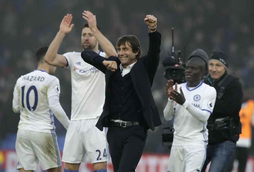Chelsea's manager Antonio Conte celebrates with his players after they won the English Premier League soccer match between Crystal Palace and Chelsea at Selhurst Park stadium in London, Saturday Dec. 17, 2016. (AP Photo/Matt Dunham)