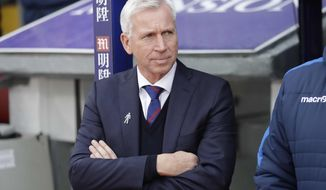 Palace manager Alan Pardew takes his place before the English Premier League soccer match between Crystal Palace and Chelsea at Selhurst Park stadium in London, Saturday Dec. 17, 2016. (AP Photo/Matt Dunham)