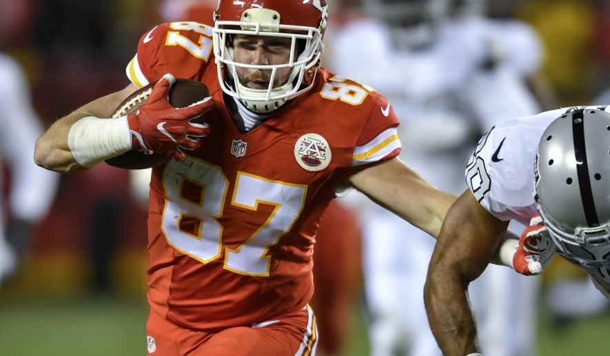 FILE - In this Oct. 23, 2016 file photo, Kansas City Chiefs tight end Travis Kelce (87) tries to get away from Oakland Raiders strong safety Nate Allen (20) during the first half of their NFL football game in Kansas City, Mo. The Chiefs could have their playoff berth assured before kickoff against the Broncos on Sunday night, Dec. 25  provided the Pittsburgh Steelers knock off the Baltimore Ravens earlier in the day. (AP Photo/Reed Hoffmann, File)