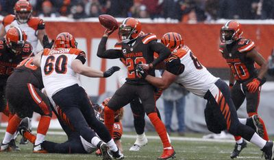 FILE - In this Dec. 11, 2016 file photo, Cleveland Browns cornerback Joe Haden (23) attempts a lateral after a blocked extra point in the first half of an NFL football game against the Cincinnati Bengals, in Cleveland. Browns two-time Pro Bowl cornerback Haden revealed he has been playing despite two groin injuries which will require offseason surgery. Haden said he will have the operations soon after the Jan. 1 finale at Pittsburgh. Despite the injuries, Haden has stayed on the field and this week he was named a Pro Bowl alternate. (AP Photo/Ron Schwane, File)