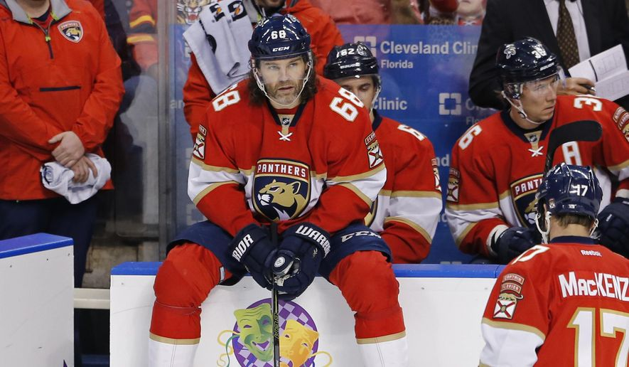 Florida Panthers right wing Jaromir Jagr (68) waits to enter the game against the Boston Bruins in an NHL hockey game, Thursday, Dec. 22, 2016, in Sunrise, Fla. Jagr began the game tied with Mark Messier for second-most points in NHL history. (AP Photo/Joe Skipper)