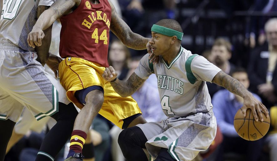 Indiana Pacers guard Jeff Teague (44) tries to defend Boston Celtics guard Isaiah Thomas (4) as he comes around the pick of Celtics forward Amir Johnson (90) during the first half of an NBA basketball game in Indianapolis, Thursday, Dec. 22, 2016. (AP Photo/Michael Conroy)