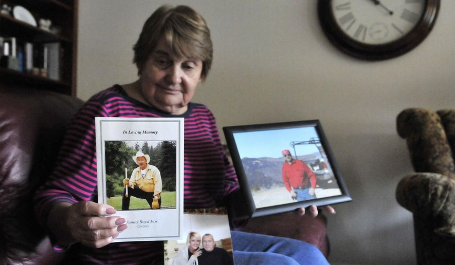 In this October 2016 photo, Rupert resident Virginia Fox shows pictures of her late husband, James 'Jim' Boyd Fox in Idaho. (Laurie Welch/The Times-News via AP)