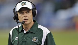FILE - In this Monday, Dec. 23, 2013 file photo, Ohio head coach Frank Solich looks on during the third quarter of the Beef 'O' Brady's Bowl NCAA college football game against East Carolina in St. Petersburg, Fla. For Solich, it will be his 13th bowl game as head man at Ohio and Nebraska, not to mention his tenure as a Cornhuskers player and assistant coach. Ohio State plays Troy on Friday, Dec. 23, 2016. (AP Photo/Chris O'Meara, File)
