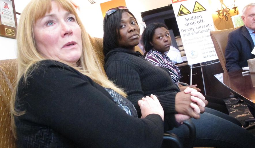 In this Oct. 25, 2016 photo, Sandra Smith, left, Tasha Hart, center, and Domonique McNeil, right, attend a news conference in Egg Harbor Township N.J., about the drowning deaths of relatives at a beach in North Wildwood N.J. A New Jersey town being sued for the drowning death of a man swept out to sea when the sand collapsed underneath him says it is immune from lawsuits due to a state law governing unimproved public property. North Wildwood claims the law puts the risk for use of such property on the user. The lawyer for one of the victims' family says the town was negligent in its supervision of a public recreational facility.(AP Photo/Wayne Parry)