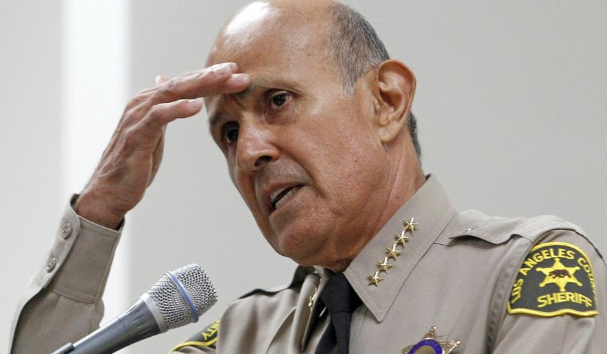 FILE - In this Oct. 3, 2012, file photo, Los Angeles County Sheriff Lee Baca, speaks in Los Angeles. A federal judge has declared a mistrial in the corruption trial of former Los Angeles County Sheriff Baca after jurors said they were hopelessly deadlocked. The judge made the decision Thursday, Dec. 22, 2016, as the jury was in its third day of deliberations. (AP Photo/Reed Saxon, File)