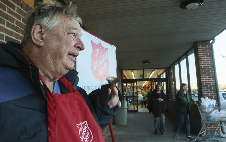 ADVANCE FOR USE SATURDAY, DEC. 24 - In this Dec. 9, 2016 photo, Salvation Army bell ringer James White rings his bell outside of Quality Foods in Anderson, S.C. He's been out in the community to welcome Christmas shoppers every year since 1995, typically ringing the bell for 40 hours a week or more, (Ken Ruinard/The Independent-Mail via AP)