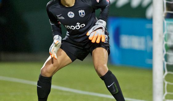 FILE - In this Oct. 1, 2015, file photo, Seattle Reign FC goalkeeper Hope Solo follows the action during the second half of the NWSL soccer championship match in Portland, Ore. Hope Solo says she hopes that someday she can return to the U.S. women's national team, but in the meantime she vows to keep fighting for equal pay for the players, Thursday, Dec. 22, 2016. (AP Photo/Craig Mitchelldyer, File)