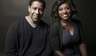 """In this Saturday, Dec. 17, 2016 photo, Denzel Washington, left, and Viola Davis pose for a portrait at the Four Seasons, in Los Angeles. Washington and Davis star in Washington's adaptation of the August Wilson play """"Fences."""" (Photo by Rich Fury/Invision/AP)"""