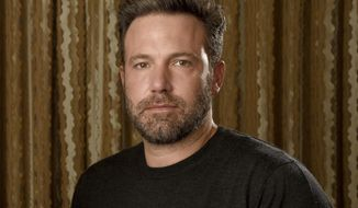 """FILE - In this Sept. 30, 2016 photo, Ben Affleck poses at The Four Seasons Hotel in Los Angeles. Affleck is hoping to flip the script again. In between """"Batman"""" movies, he's releasing his directorial follow-up to his Oscar-winning """"Argo"""": """"Live By Night,"""" adapted from Dennis Lehane's crime novel about a Prohibition era-gangster (Affleck) who decamps from Boston to Ybor City, Florida, to create a rum-running empire.  (Photo by Chris Pizzello/Invision/AP, File)"""