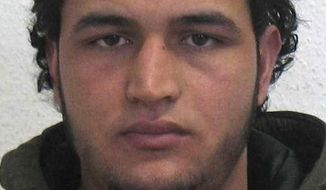 The wanted photo issued by German federal police on Wednesday, Dec. 21, 2016, shows 24-year-old Tunisian Anis Amri who is suspected of being involved in the fatal attack on the Christmas market in Berlin on Dec. 19, 2016. German authorities are offering a reward of up to 100,000 euros ($105,000) for the arrest of the Tunisian. (German police via AP)