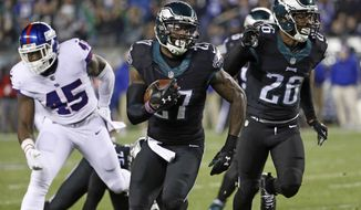 Philadelphia Eagles' Malcolm Jenkins (27) runs for a touchdown after intercepting a pass during the first half of an NFL football game against the New York Giants, Thursday, Dec. 22, 2016, in Philadelphia. (AP Photo/Michael Perez)