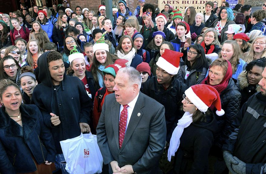 """Maryland Gov. Larry Hogan sings """"Jingle Bells"""" with students from the Barbara Ingram School for the Arts in Hagerstown, Md., on Thursday, Dec. 22, 2016. Hogan pledged more than $7 million in state funds to help the city with a downtown revitalization plan anchored by educational and arts institutions, including the public high school. (Ric Dugan/The Herald-Mail via AP)"""