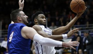 Northwestern guard Isiah Brown, right, drives to the basket against Houston Baptist center Cody Stetler during the first half of an NCAA college basketball game Thursday, Dec. 22, 2016, in Evanston, Ill. (AP Photo/Nam Y. Huh)