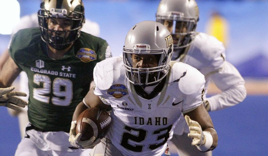 Idaho running back Aaron Duckworth (23) runs the ball during the second half of the Famous Idaho Potato Bowl NCAA college football game against Colorado State in Boise, Idaho, Thursday, Dec. 22, 2016. (AP Photo/Otto Kitsinger)