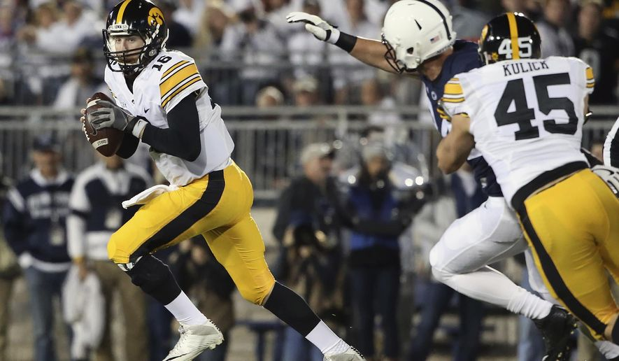 FILE - In this Saturday, Nov. 5, 2016, file photo, Iowa quarterback C.J. Beathard (16) scrambles out of the pocket against Penn State during the first half of an NCAA college football game in State College, Pa. Beathard enters his final game with Iowa for the Outback Bowl against No. 21 Florida on Jan. 2, 2017.  (AP Photo/Chris Knight, File)