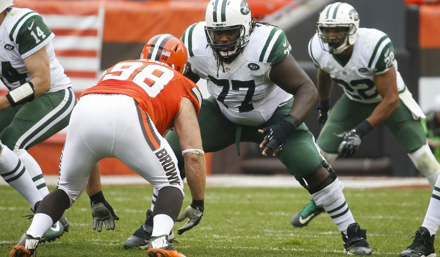 FILE - In this Sunday, Oct. 30, 2016 file photo, New York Jets guard James Carpenter (77) defends against Cleveland Browns defensive end Jamie Meder (98) in the second half of an NFL football game in Cleveland. The New York Jets have lost four of their five projected starting offensive linemen to season-ending injuries this year, and Carpenter, the left guard, is the only one to start every game. (AP Photo/Ron Schwane, File)