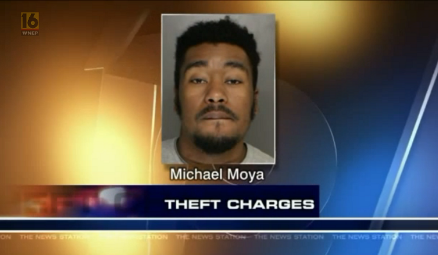 Michael Moya, accused of stealing cash from a Toys for Tots donation canister, is shown here in this mug shot in a story aired on WNEP-TV. Screen capture from video at http://wnep.com/2016/12/21/suspected-toys-for-tots-thief-nabbed-in-monroe-county/