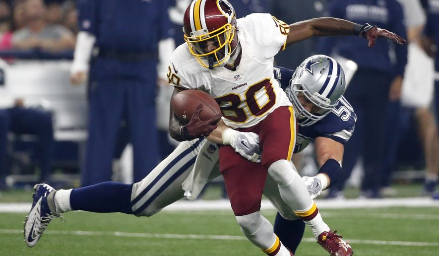 FILE - In this Thursday, Nov. 24, 2016 file photo, Washington Redskins wide receiver Jamison Crowder (80) attempts to escape a tackle by Dallas Cowboys' Sean Lee (50) during the second half of an NFL football game in Arlington, Texas. This has not been the most watchable of NFL seasons, although the action and entertainment value has picked up in the second half of the schedule. What has emerged is the rise of four teams who are downright fun to watch: the Falcons, Titans, Redskins and Raiders. (AP Photo/Michael Ainsworth, File)