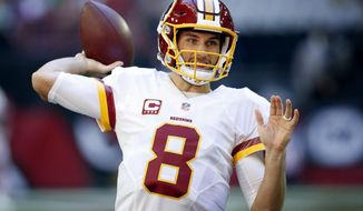FILE - In this Sunday, Dec. 4, 2016, file photo, Washington Redskins quarterback Kirk Cousins (8) warms up prior to an NFL football game against the Arizona Cardinals in Glendale, Ariz. The Redskins play the Chicago Bears on Saturday, Dec. 24. (AP Photo/Ross D. Franklin, File)