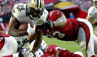 FILE - In this Dec. 18, 2016, file photo, New Orleans Saints running back Tim Hightower (34) scores a touchdown as Arizona Cardinals defensive end Calais Campbell (93) defends during the second half of an NFL football game in Glendale, Ariz. Hightower has rushed for 490 yards and three touchdowns this season, making this the third-most productive season of his career so far. (AP Photo/Ross D. Franklin, File)