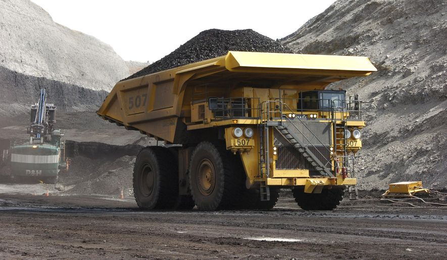 FILE - In this April 4, 2013, file photo, a mining dumper truck hauls coal at Cloud Peak Energy's Spring Creek strip mine near Decker, Mont. Renewable energy developers say they're hopeful about the future despite President-elect Donald Trump's promise to bring coal mining jobs back. In recent years, huge solar and wind farms have sprouted up on public desert land in the Western United States buoyed by generous federal tax credits. (AP Photo/Matthew Brown, File)