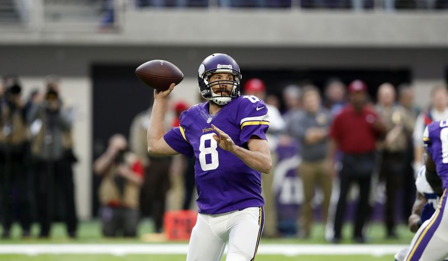 FILE - In this Dec. 18, 2016 file photo, Minnesota Vikings quarterback Sam Bradford throws during the first half of an NFL football game against the Indianapolis Colts in Minneapolis. The fortunes of the Vikings and Green Bay Packers are headed in opposite directions as the division rivals meet on Christmas Eve. (AP Photo/Charlie Neibergall, File)