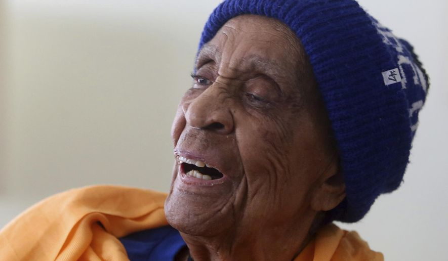 In this April 24, 2016, photo, Golden State Warriors fan Helen Brooks, better known as Sweetie, smiles as she watches an NBA playoff basketball game between the Warriors and the Houston Rockets on television in Castro Valley, Calif. Brooks, a 107-year-old Northern California woman who gained fame very late in life as an avid and gregarious fan of the Warriors, died Thursday Dec. 22, 2016. (Aric Crabb/Bay Area News Group via AP) /San Jose Mercury News via AP)