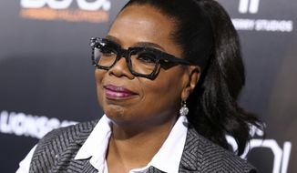 Oprah Winfrey, shown in this Oct. 2016, file photo, said in a Jan. 25, 2017, interview that she was moved to tears by the passing of Mary Tyler Moore, whom she credited with inspiring her to success in television broadcasting. (Photo by John Salangsang/Invision/AP, File)