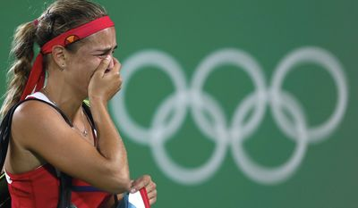 FILE - In this Aug. 13, 2016, file photo, Monica Puig, of Puerto Rico, cries after winning the gold medal match in the women's tennis competition at the 2016 Summer Olympics in Rio de Janeiro, Brazil. She earned her nation's first gold medalist in any sport at any Olympics. (AP Photo/Vadim Ghirda, File)