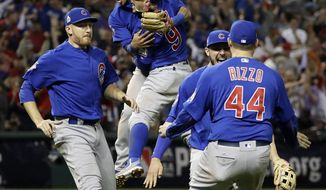 FILE - In this Nov. 3, 2016 file photo, the Chicago Cubs celebrate after Game 7 of the Major League Baseball World Series against the Cleveland Indians in Cleveland. The Cubs won 8-7 in 10 innings to win the series 4-3. (AP Photo/David J. Phillip, File)
