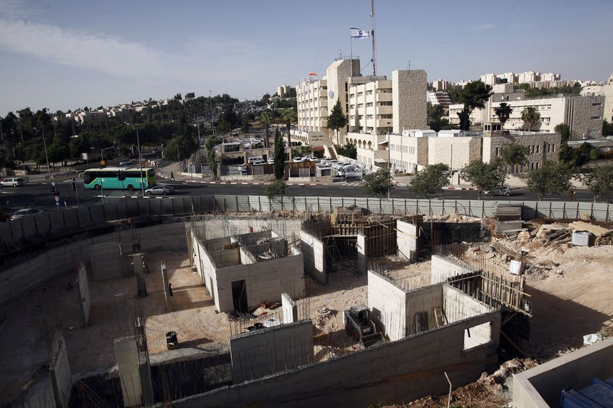 This May 17, 2016, file photo shows construction on land owned by Palestinian Mohammad Abu Ta'a, in east Jerusalem. Abu Ta'a discovered some years ago that the Israeli government had expropriated the piece of land in Jerusalem belonging to his family and handed it over to a leading organization that oversees Jewish settlement building in the West Bank. (AP Photo/Mahmoud Illean) ** FILE **
