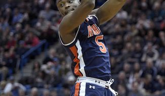 Auburn's Mustapha Heron (5) grabs a rebound during the first half of an NCAA college basketball game against Connecticut in Hartford, Conn., on Friday, Dec. 23, 2016. (AP Photo/Fred Beckham)