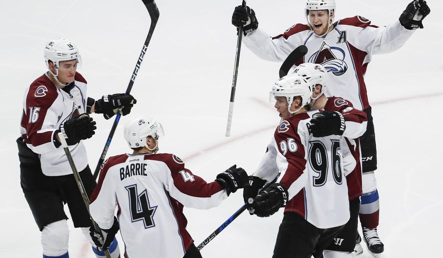 Colorado Avalanche right wing Mikko Rantanen (96) celebrates with teammates after scoring against the Chicago Blackhawks during the third period of an NHL hockey game Friday, Dec. 23, 2016, in Chicago. (AP Photo/Kamil Krzaczynski)