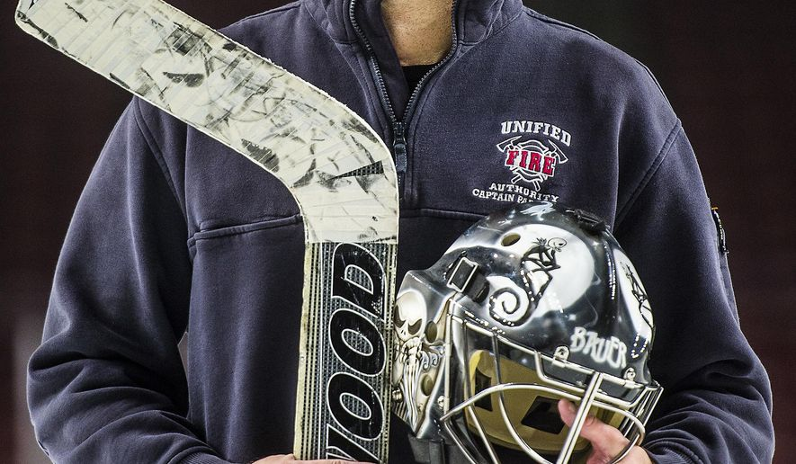 ADVANCE FOR WEEKEND EDITIONS, DEC. 24-25 - In this Wednesday, Dec. 14, 2016 photo, Unified firefighter Jay Stevens poses for a portrait at the Maverik Center in West Valley City, Utah. Stevens is an emergency back-up goaltender for the Utah Grizzlies who put in his first minutes of game time 16 years after joining the team. (Chris Detrick/The Salt Lake Tribune via AP)