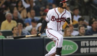 FILE - In this June 28, 2016 file photo, Atlanta Braves' Ender Inciarte follows through on a run-base hit in the sixth inning of a baseball game against the Cleveland Indians, in Atlanta.  Inciarte avoided salary arbitration with the Atlanta Braves, agreeing to a $30,525,000, five-year contract. The deal, announced Friday, Dec. 23 covers four years of arbitration eligibility and one year of free agency, and gives Atlanta a club option for 2022. (AP Photo/John Bazemore, File)