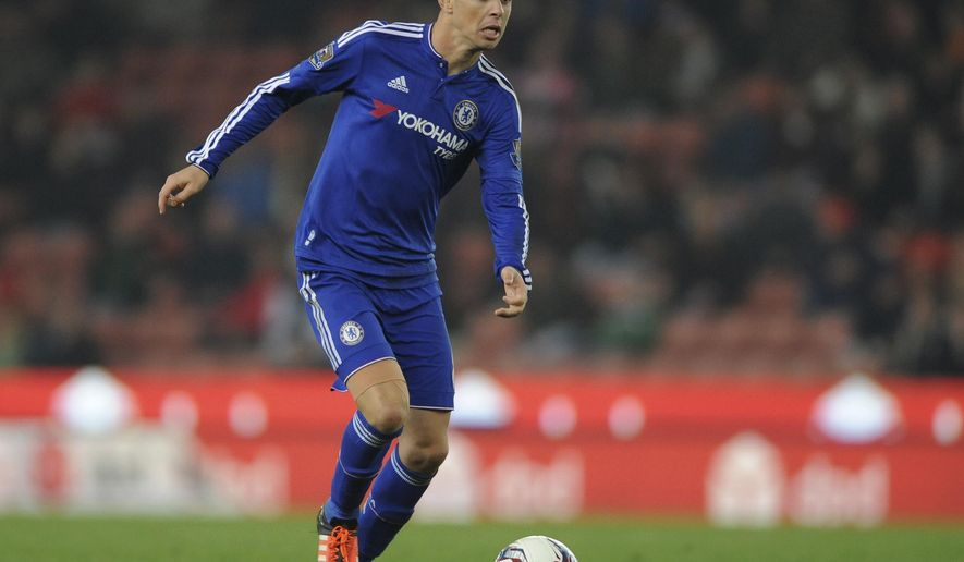 FILE - In this Tuesday, Oct. 27, 2015 file photo Chelsea's Oscar runs with the ball during the English League Cup Fourth Round soccer match between Stoke City and Chelsea at the Britannia Stadium, Stoke on Trent, England. Brazil playmaker Oscar became the latest high-profile player to be lured to the cash-rich Chinese Super League when he sealed a move to Shanghai SIPG from Chelsea for a reported 60 million pounds ($73.5 million) on Friday Dec. 23, 2016. (AP Photo/Rui Vieira, File)