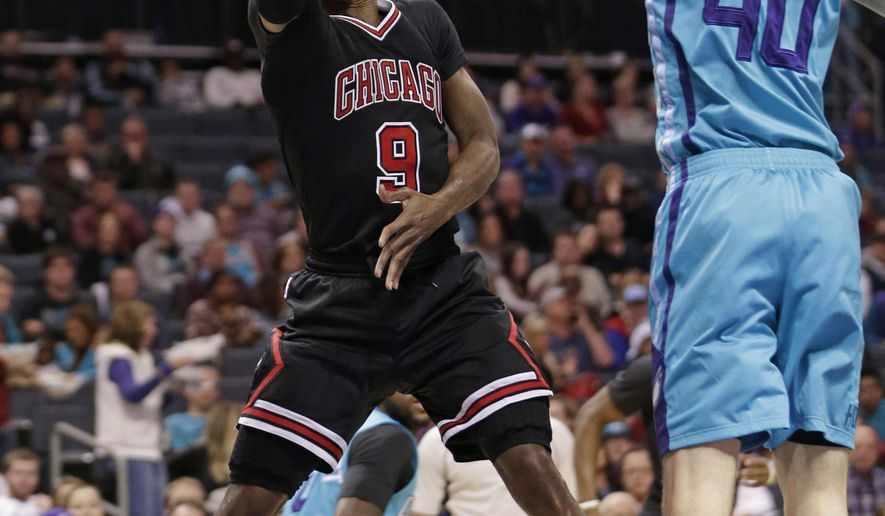Chicago Bulls' Rajon Rondo (9) drives past Charlotte Hornets' Cody Zeller (40) in the first half of an NBA basketball game in Charlotte, N.C., Friday, Dec. 23, 2016. (AP Photo/Chuck Burton)