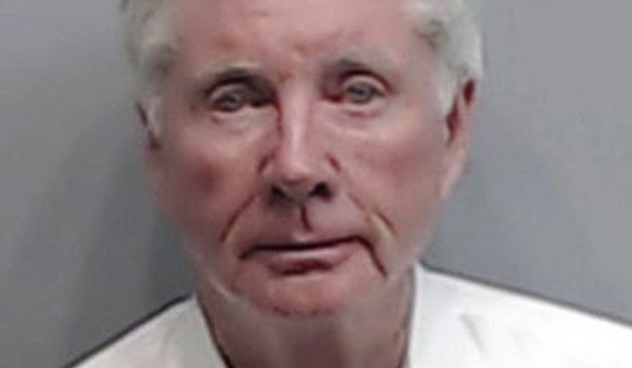"""This Wednesday, Dec. 21, 2016 photo released by the Fulton County Sheriff's Office shows Claud """"Tex"""" McIver, a prominent Atlanta attorney was booked into jail to face charges in the shooting death of his business executive wife, Diane McIver. Fulton County Jail records Thursday, Dec. 22, show that McIver was charged with felony involuntary manslaughter and a misdemeanor count of reckless conduct. (Fulton County Sheriff's Office via AP)"""