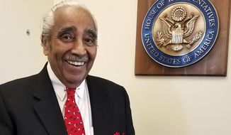 """In this Dec. 19, 2016 photo, U.S. Rep. Charles Rangel, D-NY, smiles in his New York office in Harlem after an interview with The Associated Press. Rangel thought he would be wrapping up his 46-year career in Congress on a note of triumph, leaving office at the same time as a history-making fellow Democrat, President Barack Obama, with the country in the hands of longtime friend Hillary Clinton. Instead, he said he is exiting to """"a nightmare,"""" the ascendancy of Donald Trump. (AP Photo/Deepti Hajela)"""