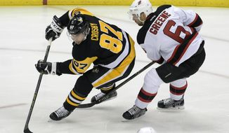 Pittsburgh Penguins center Sidney Crosby (87) skates around New Jersey Devils defenseman Andy Greene (6) during the first period of an NHL hockey game on Friday, Nov. 23, 2016, in Pittsburgh. (AP Photo/Fred Vuich)